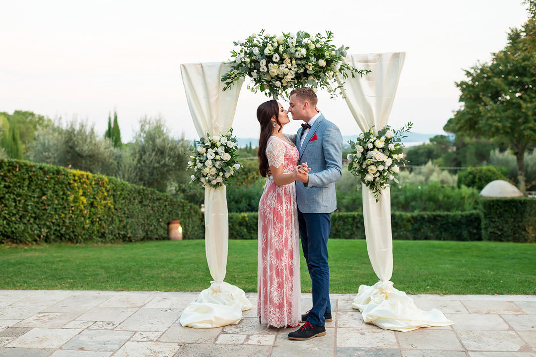 flower arch wedding tuscany